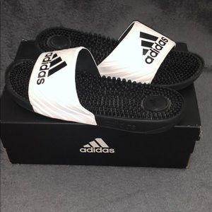 Black and white adidas slides